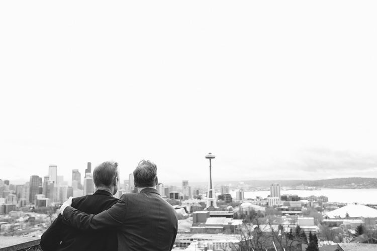 gay wedding portraits seattle looking at the space needle romantic same-sex photography
