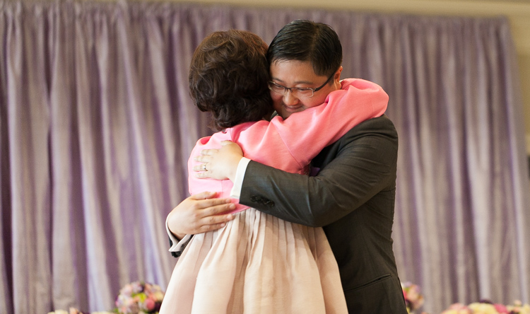 groom hugging his mom