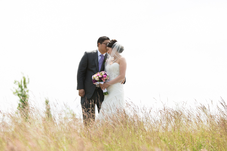 bride and groom photography in tall grass