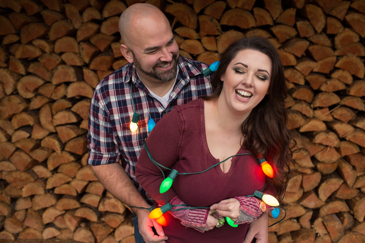 holiday photos seattle, seattle christmas card photographer, seattle portrait photographer, seattle engagement photographer, couple wrapped in christmas lights