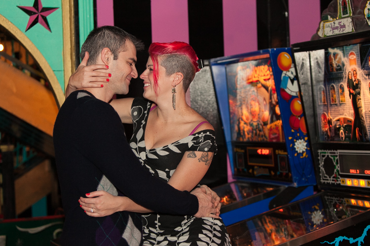 couple kissing on pinball machine