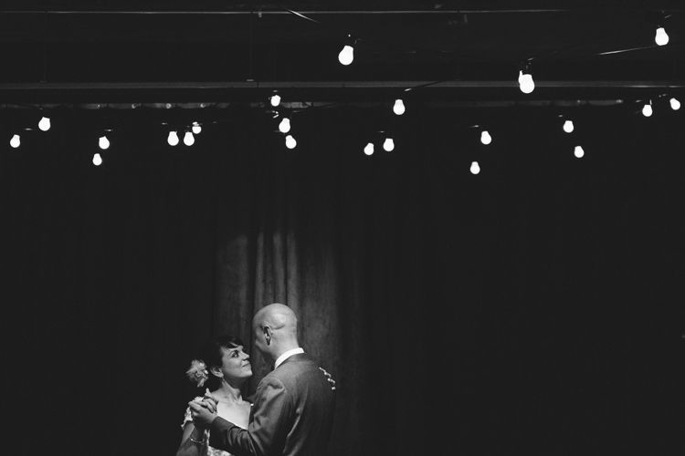 bride and groom share first dance at melrose market studios