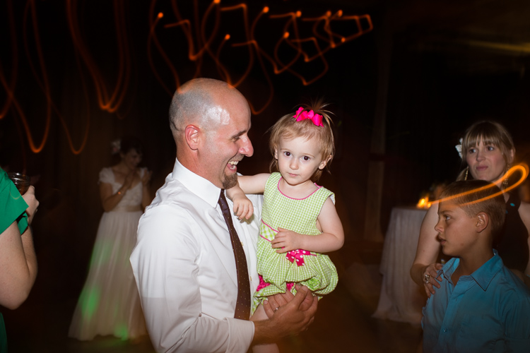 best man and daughter at wedding reception