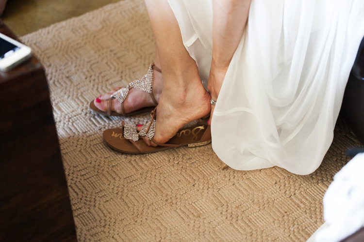 bride putting on sandals