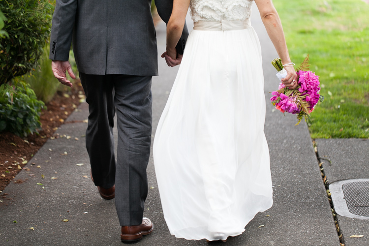 bride and groom holding hands walking to ceremony