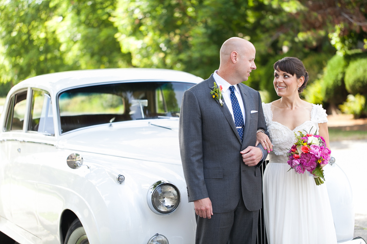bride and groom in front of classic british motorcoach