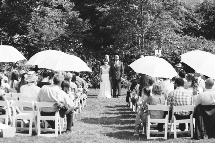umbrellas for sunny outdoor wedding ceremony