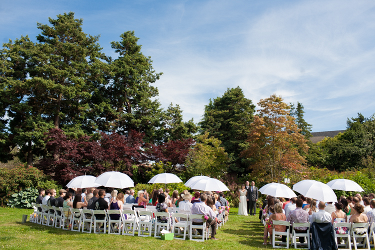 outdoor summer wedding ceremony with umbrellas