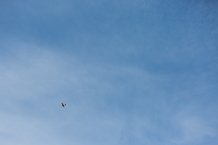airplane flying over wedding ceremony