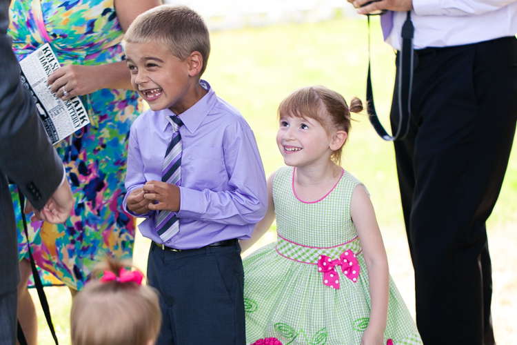 cute kids laughing during wedding