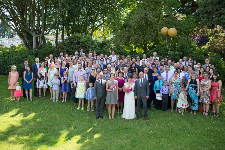 huge group wedding photo at outdoor wedding