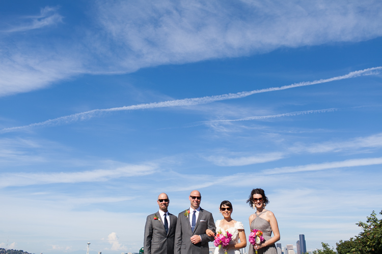 small wedding party and seattle skyline