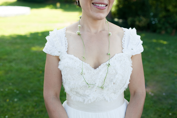 bride wearing handmade flower necklace