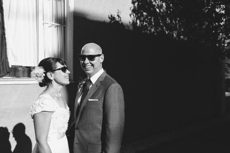 cool bride and groom in sunglasses for formals