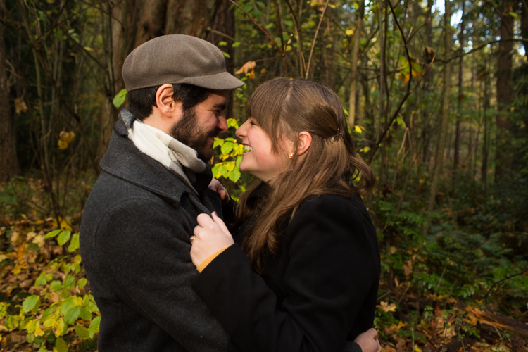 laughing couple in fall engagement