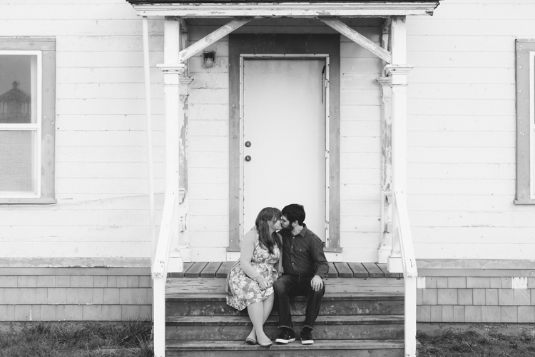 couple kissing on a porch
