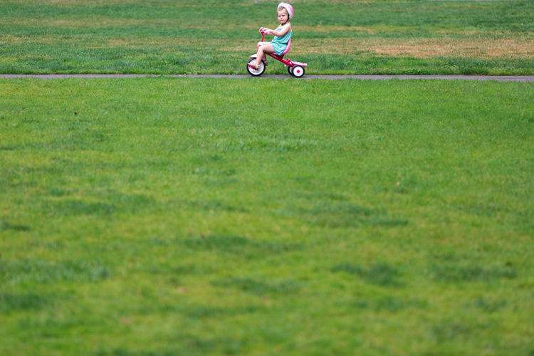 little kid on tricycle
