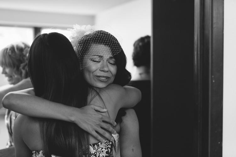 bride hugging guest