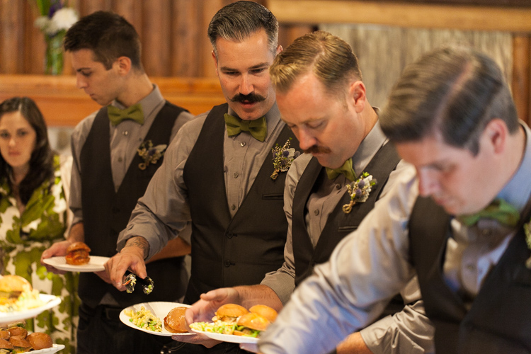 guests eating from reception buffet