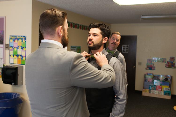 groomsmen in grey and green