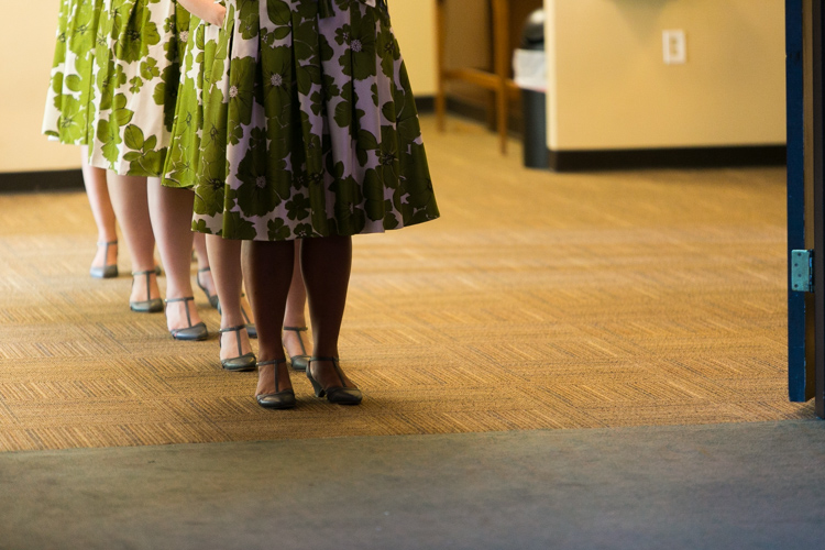 bridesmaids in green floral dresses