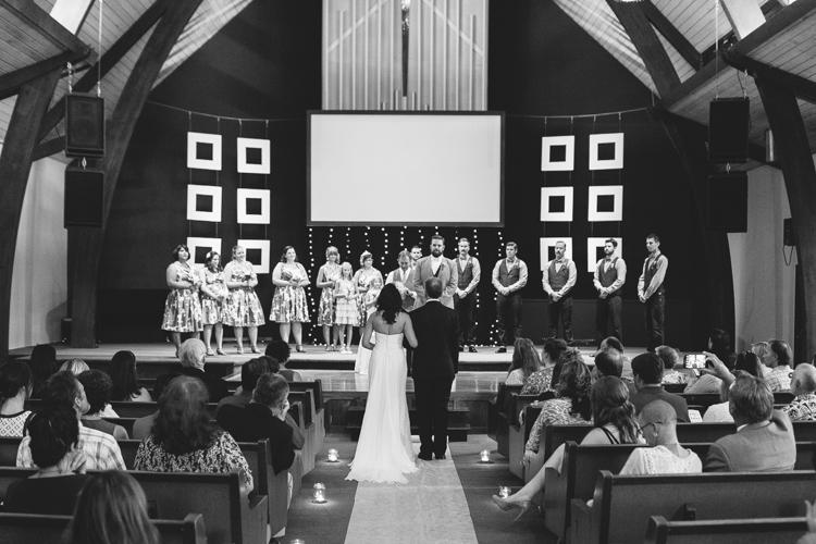 wedding party at altar of church