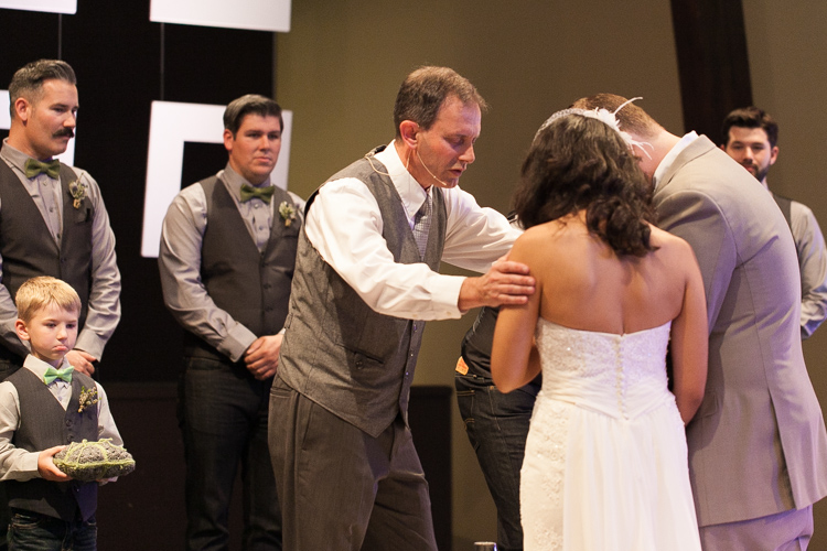 pastor officiating wedding ceremony