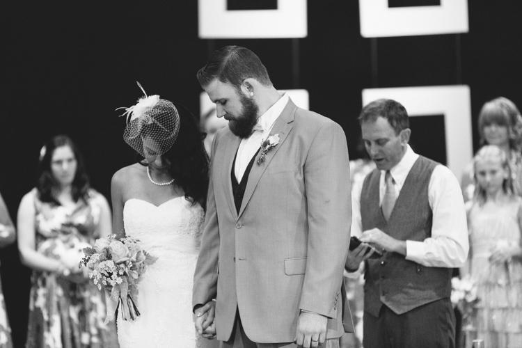 bride and groom praying during wedding