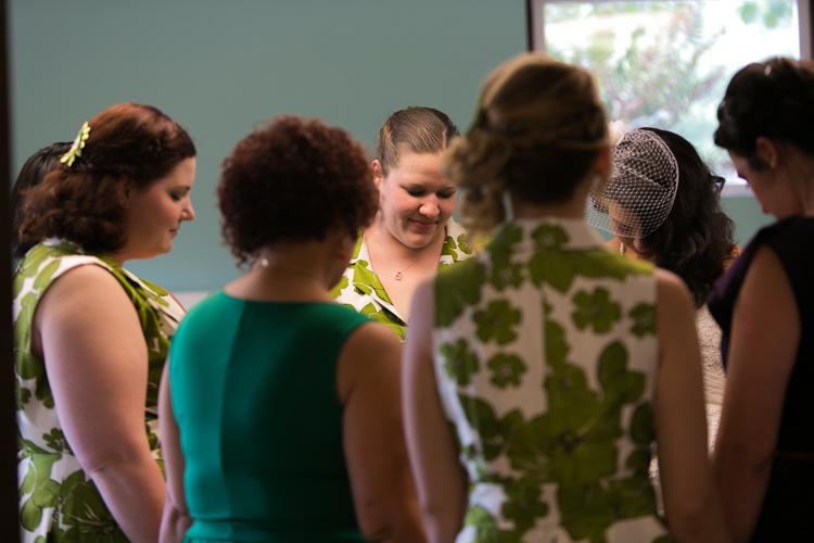 wedding party praying before wedding