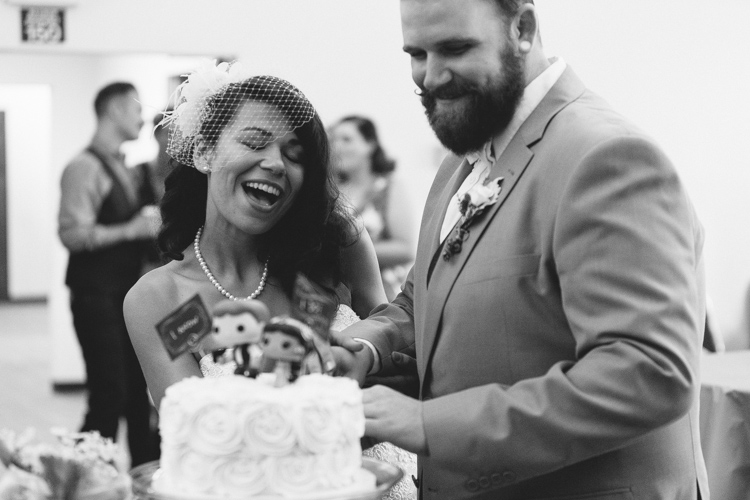 bride and groom cut cake at reception