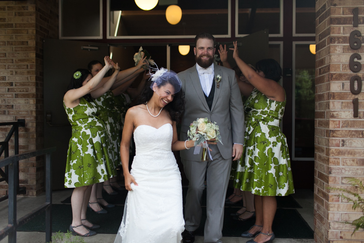 bride and groom leaving reception
