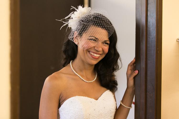bride in birdcage veil and cloth flower headpiece