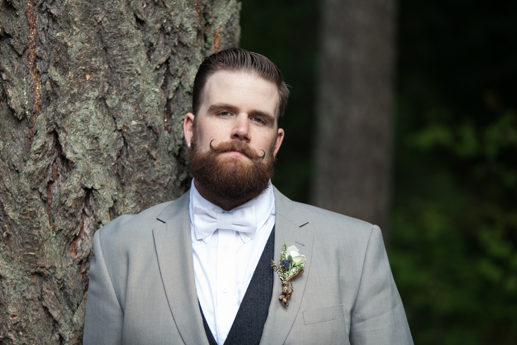 groom moustache and bowtie