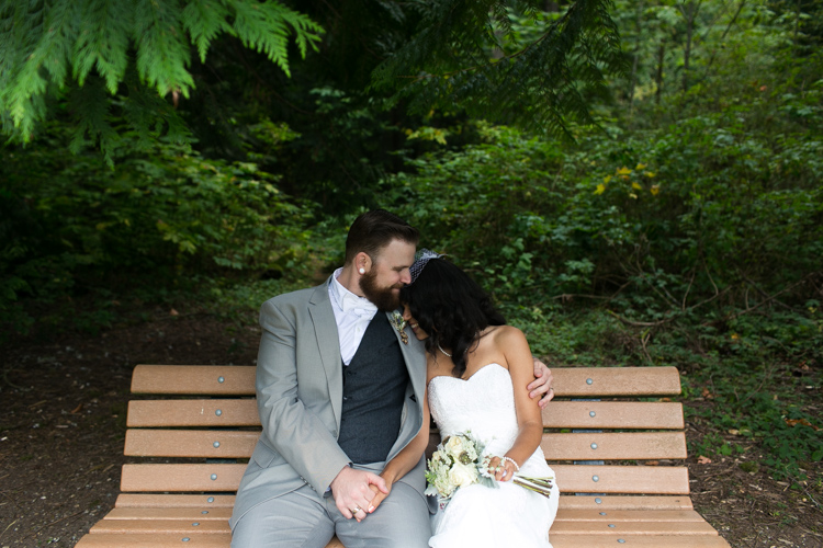 bride and groom on bench formals