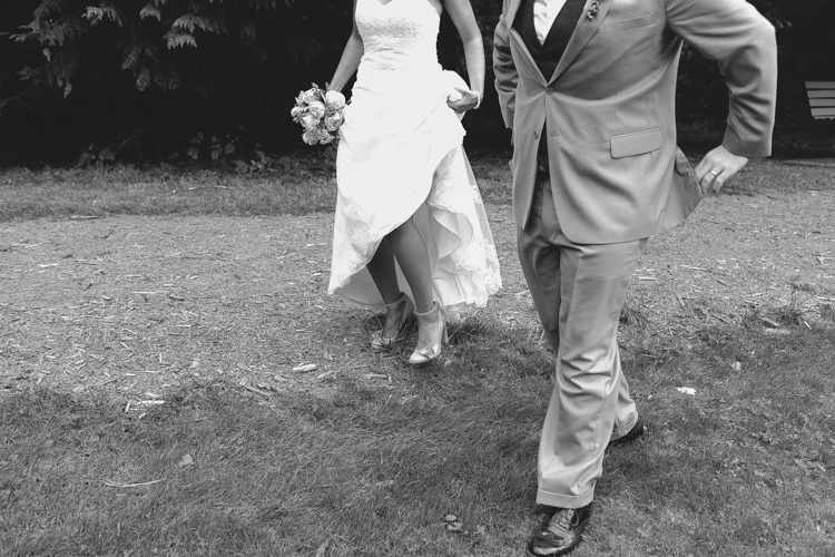 bride and groom formals in field