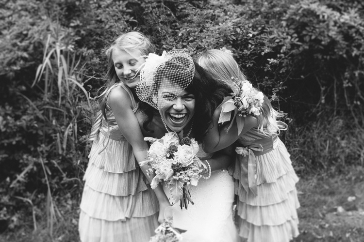 bride and flowergirls laughing
