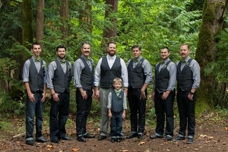 hip groomsmen in grey vests and bowties
