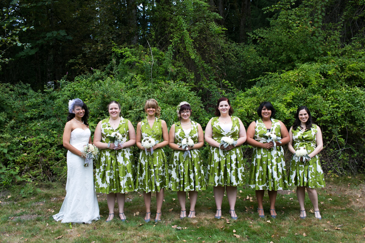 bridesmaids in green and white floral dresses
