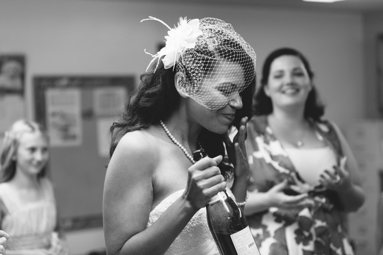 bride sipping champagne on wedding day