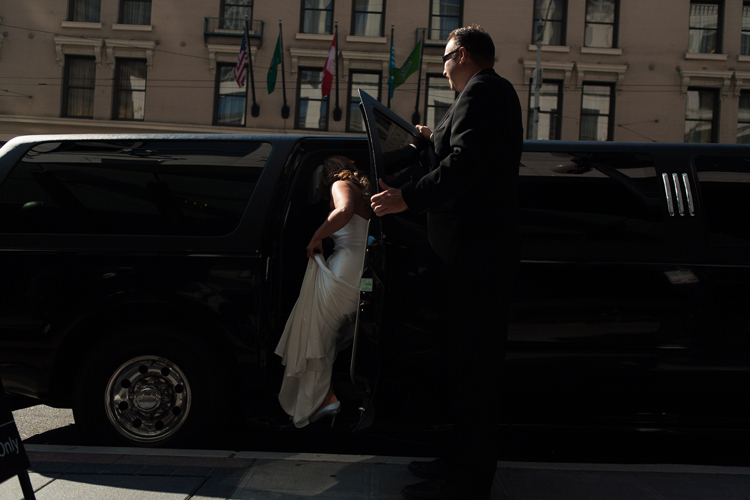 bride stepping into limo seattle wedding hotel 1000