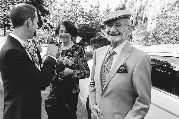 grandpa laughing at a wedding