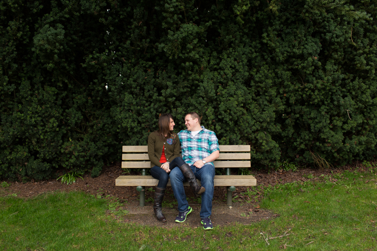 couple sitting on a bench in port townsend