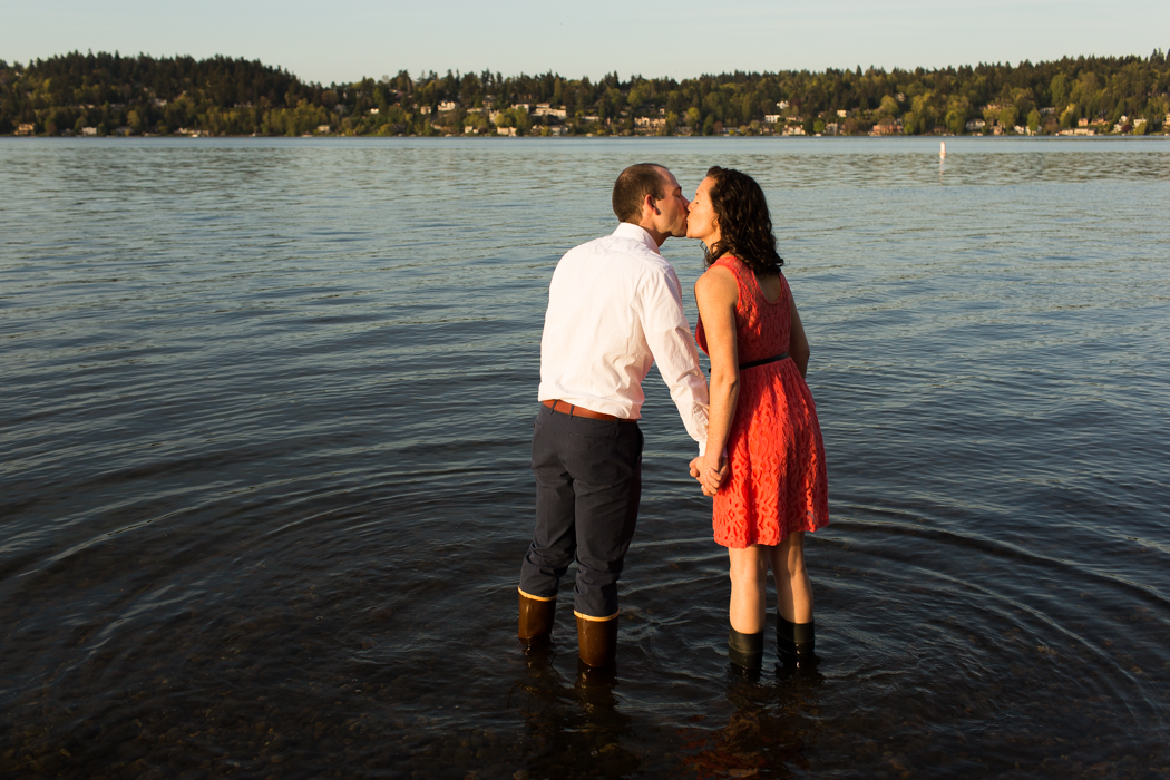 seward park engagement couple in the water rain boots