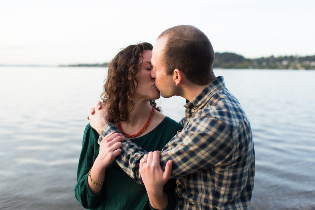 couple kissing engagement
