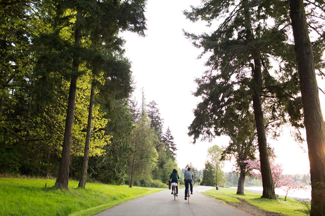 couple biking together in seward park