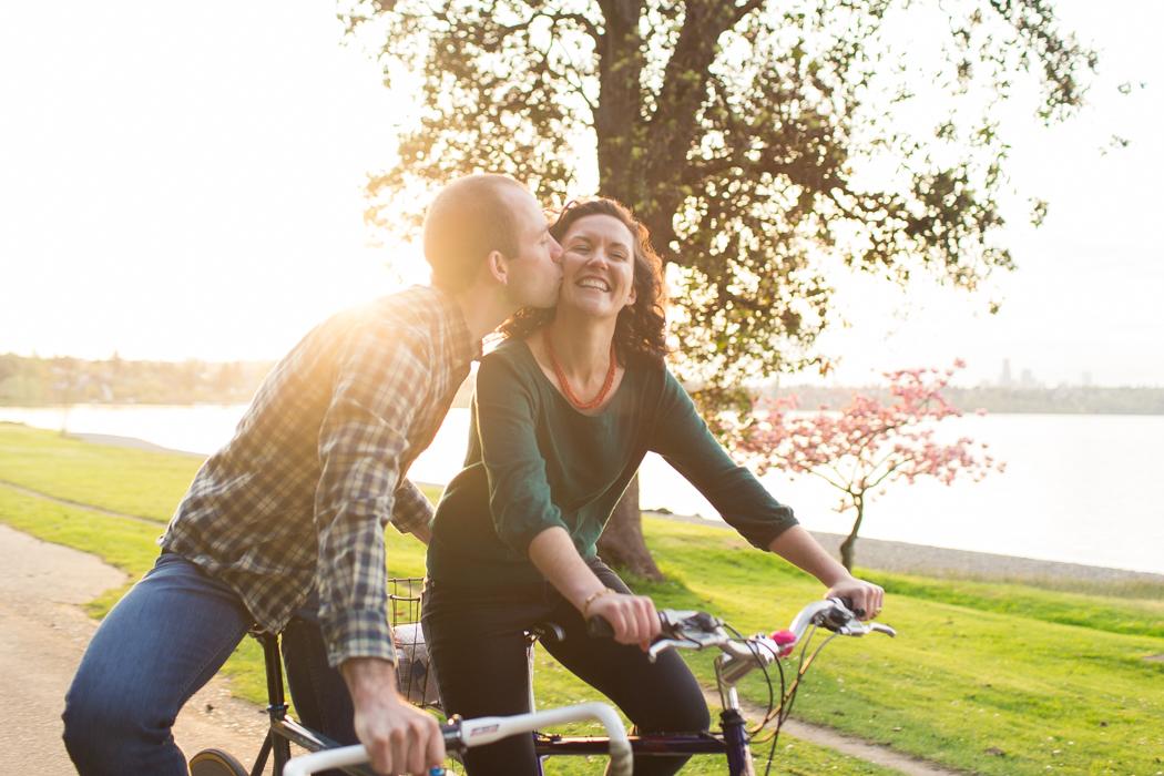 couple biking seward park sun flare