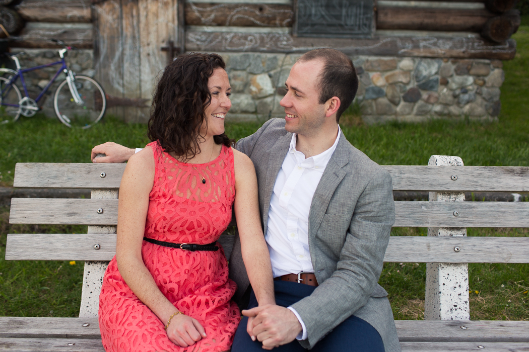 couple sitting on a bench engagement photography