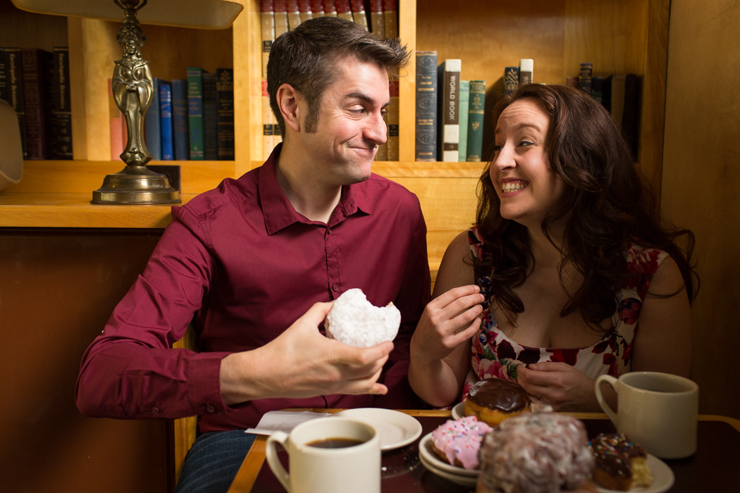 couple eating doughnuts