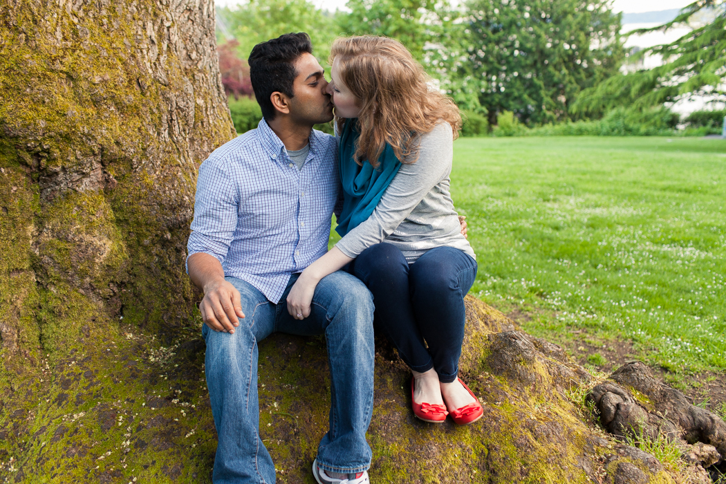 couple kissing lincoln park west seattle engagement photographers