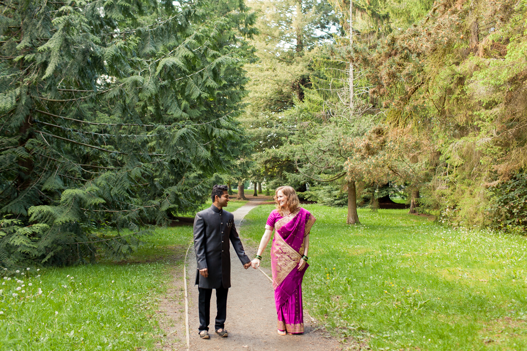couple holding hands in traditional indian wedding attire